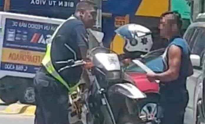 Suspenden al agente vial sorprendido en presunta extorsión