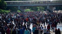 Migrantes cruzan río Suchiate en masa hacia México tras negativa del Gobierno (FOTOS)